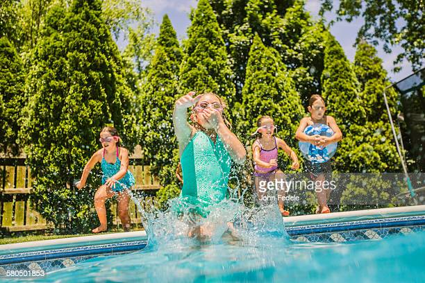 Four People Jumping Into Swimming Pool Stock Photos And Pictures Getty Images