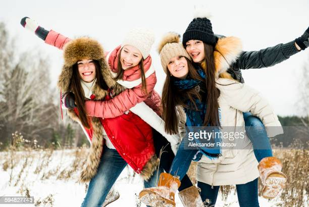 Caucasian girls playing in snow