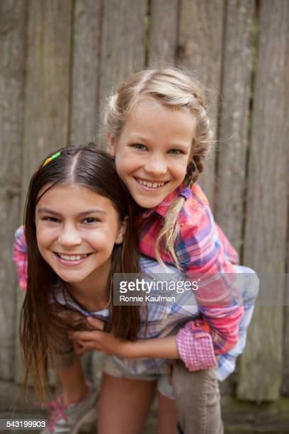 Caucasian girls playing outdoors
