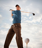 Caucasian golfer about to swing golf club