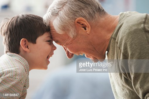 Caucasian grandfather and grandson looking at each other