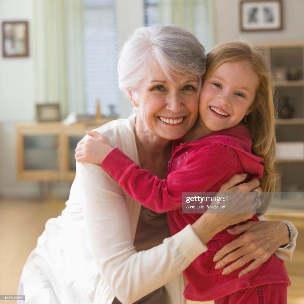 Caucasian grandmother and granddaughter hugging