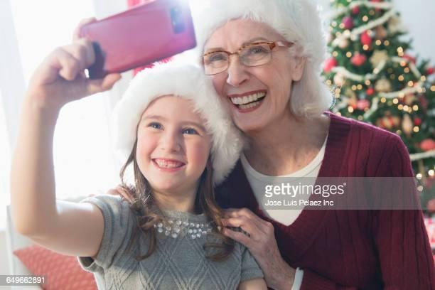 Caucasian grandmother and granddaughter taking selfie