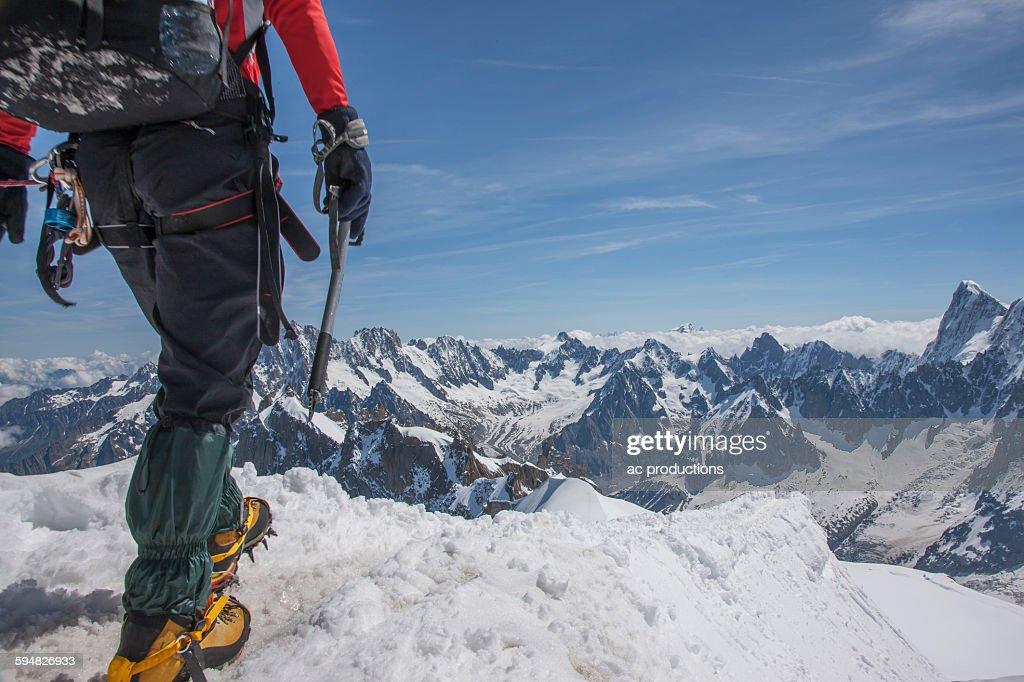Caucasian hiker on mountaintop, Mont Blanc, Chamonix, France