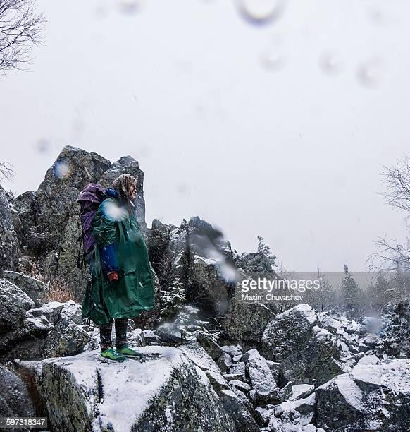 Caucasian hiker standing on rocky hillside