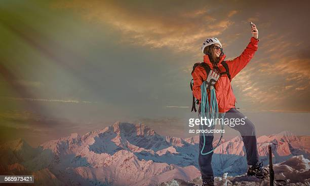 Caucasian hiker taking selfie on mountaintop, Monte Rosa, Alps, Italy