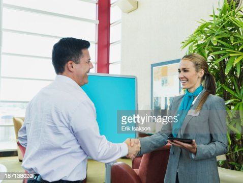 Caucasian hostess greeting businessman
