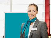 Caucasian hostess smiling
