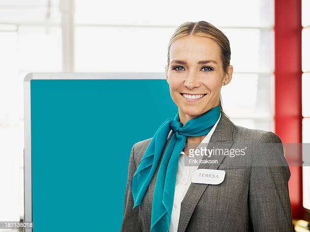 Caucasian hostess smiling