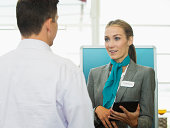 Caucasian hostess talking to businessman