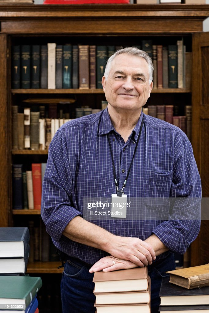 Caucasian librarian smiling in library