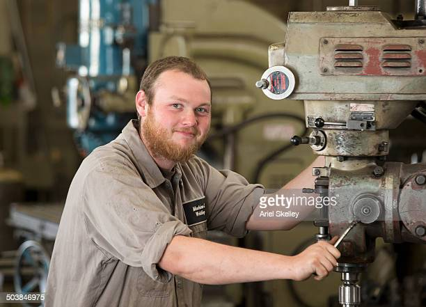 Caucasian machinist working in garage