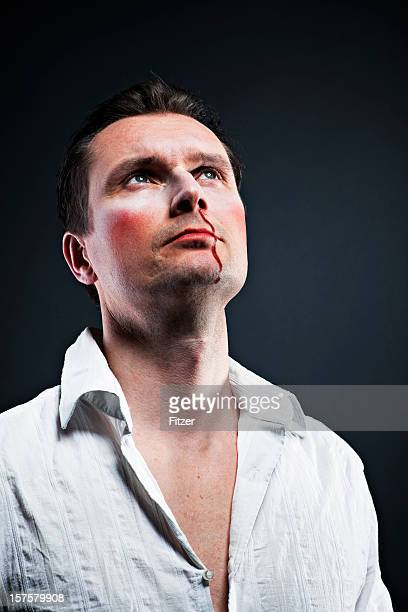 caucasian macho man half body portrait, bleeding nose