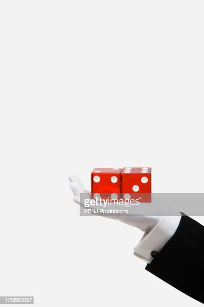 Caucasian magician holding red dice
