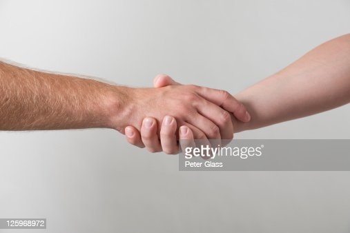 Caucasian male and female hands shaking : Stock Photo
