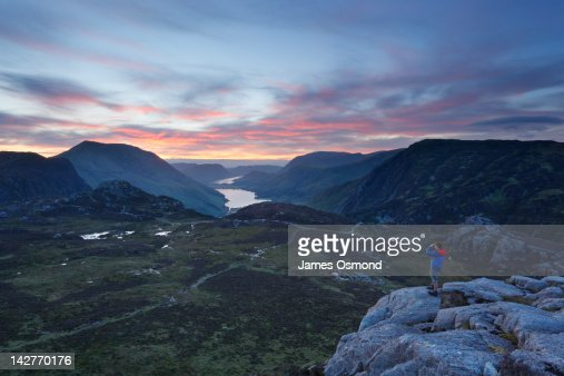 Caucasian Male Taking a Photograph at Sunset : Stock Photo