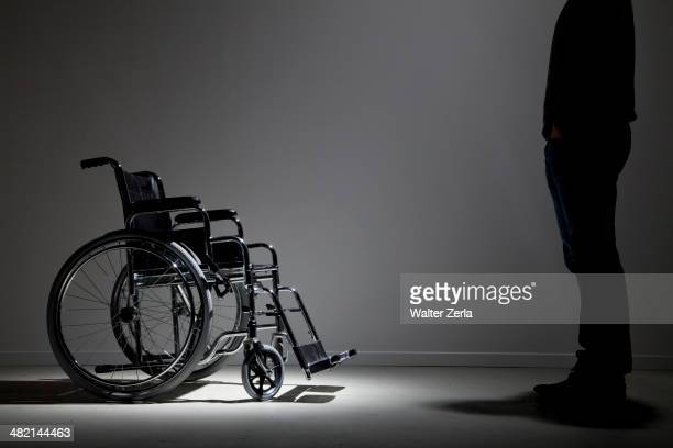 Caucasian man approaching wheelchair