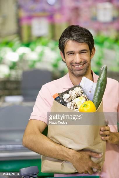 Caucasian man buying groceries