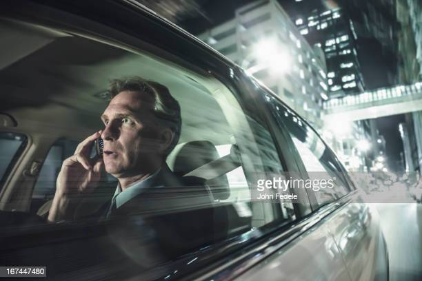Caucasian man driving and talking on cell phone