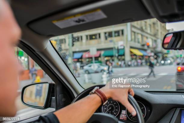 Caucasian man driving car in city