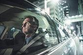 Caucasian man driving on city street