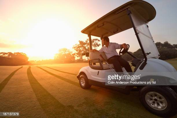 Caucasian man driving on golf course