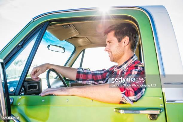 Caucasian man driving truck