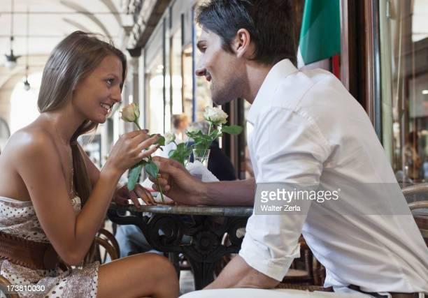 Caucasian man giving girlfriend a rose