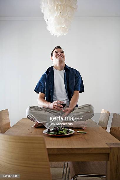 Caucasian man having dinner sitting on table