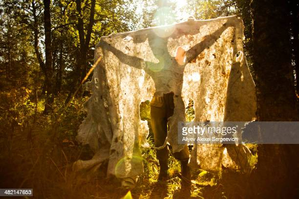 Caucasian man holding fabric outdoors