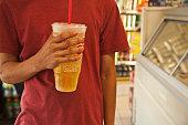 Caucasian man holding soda