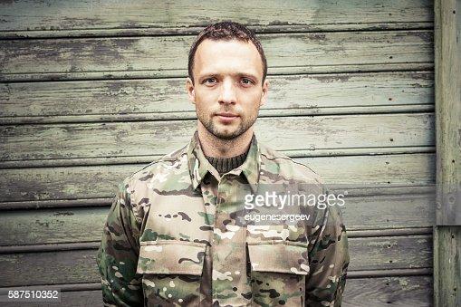 Caucasian man in camouflage uniform : Stock Photo