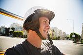 Caucasian man in helmet driving go-cart