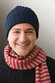Caucasian man in knit cap and scarf