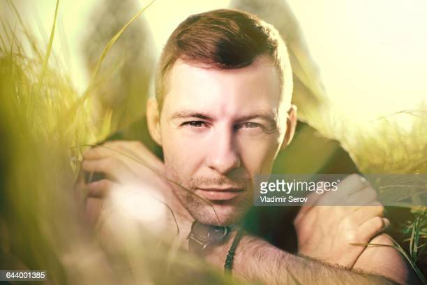 Caucasian man laying in grass