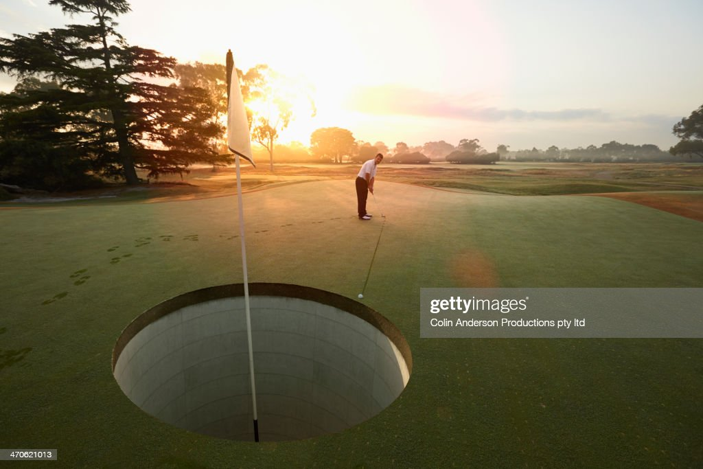 Caucasian man playing golf on course