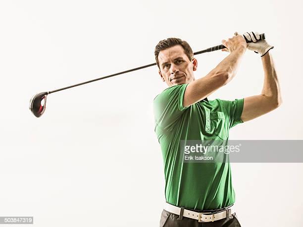 Caucasian man playing golf