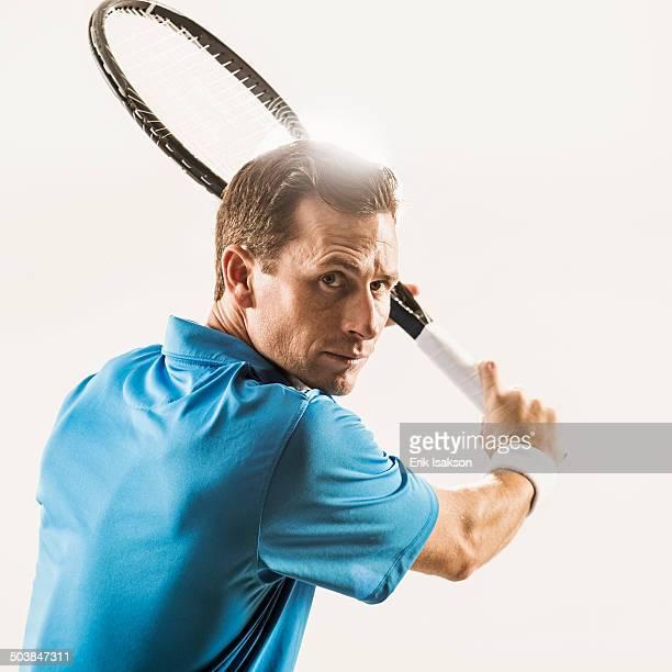 Caucasian man playing tennis