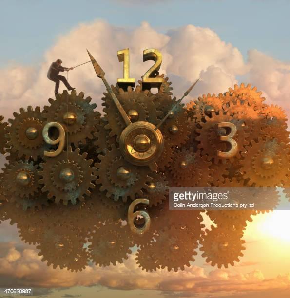 Caucasian man pulling clock hands