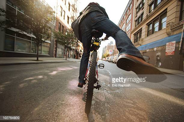 Caucasian man riding bicycle on urban street