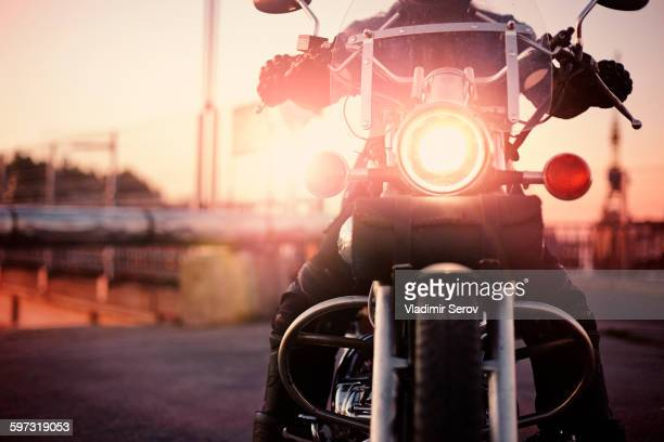 Caucasian man riding motorcycle
