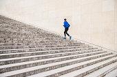 Caucasian man running up staircase