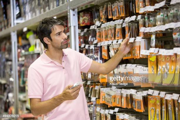 Caucasian man shopping in hardware store
