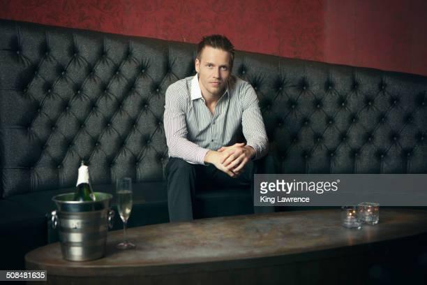 Caucasian man sitting in nightclub