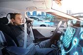 Caucasian man sleeping in autonomous car. Self driving vehicle.