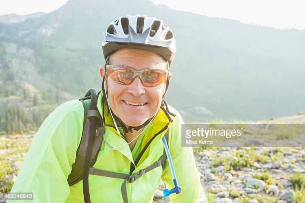 Caucasian man smiling on rocky trail