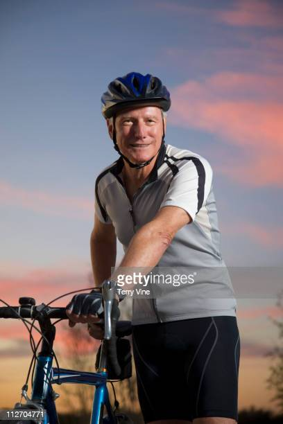 Caucasian man standing with bicycle