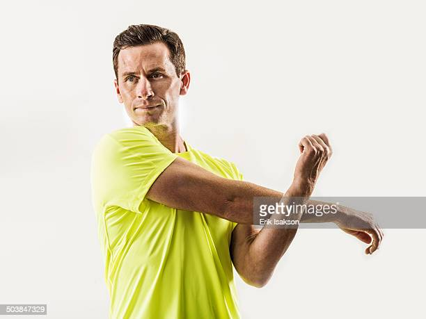 Caucasian man stretching