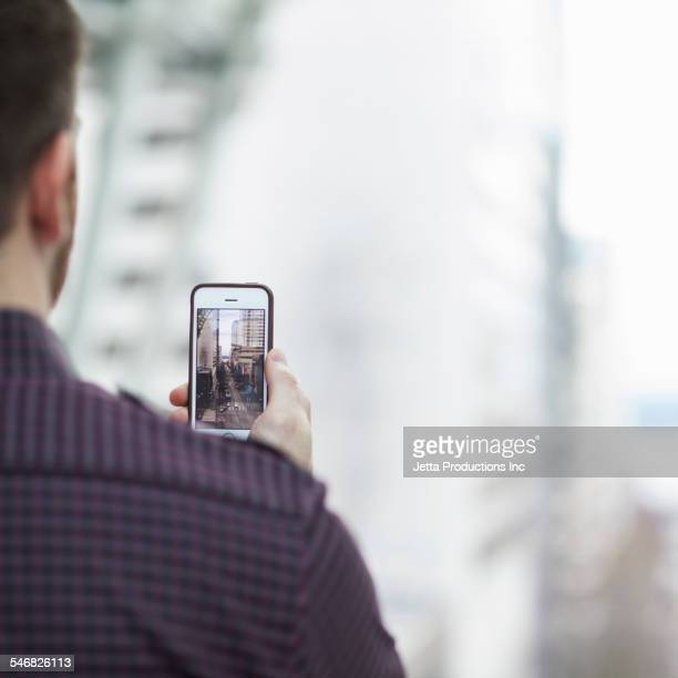 Caucasian man taking cell phone picture
