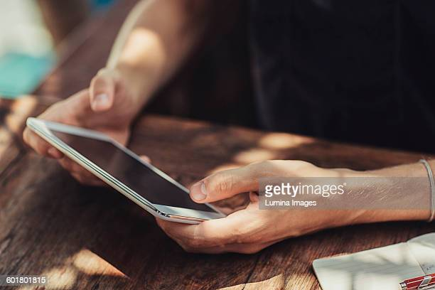 Caucasian man using cell phone at table